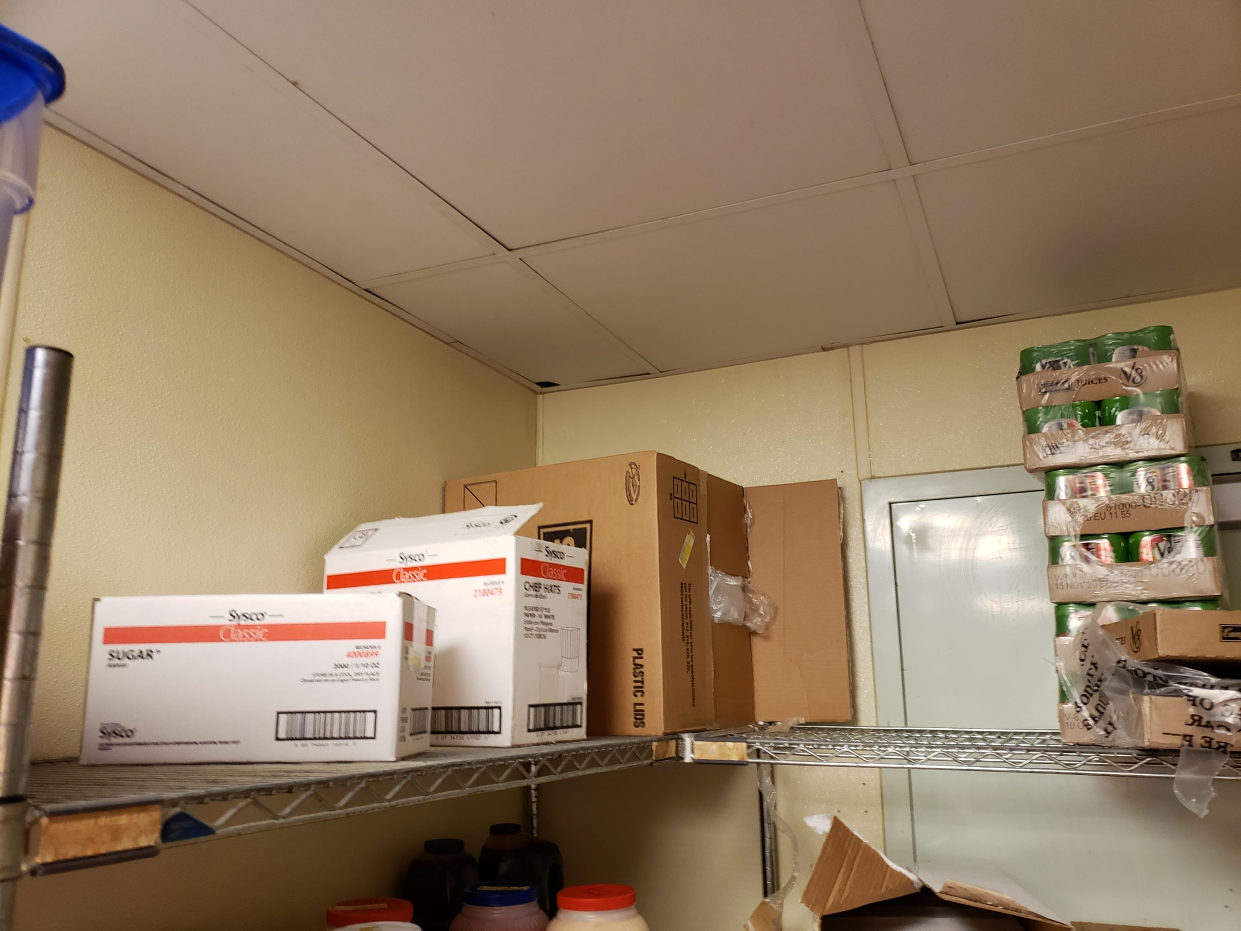 cardboard storage with mouse hole in ceiling